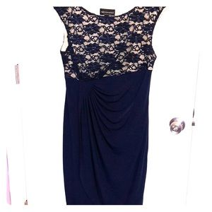 Beautiful navy dress with lace & screen background